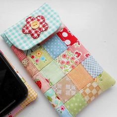 I love the versatility of the free mobile phone case tutorial by @sandracherryhrt . I added one extra column of squares so that it fit my Motorola smart phone and a cutesy gingham flower - just for me.  #patchworkphonecase