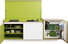 """Dubbed """"the kitchen that isn't there"""", Miniki is a modular kitchen system with a sink and cooking range design that can be folded away under a cover."""