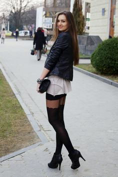 Black leather jacket patterned stockings high heel ankle boots