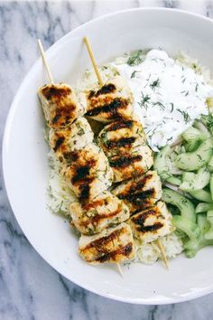 For a fun new chicken #recipe try this Grilled Chicken Kebab Bowls with Cucumber Salad and Tzatziki. #Chicken #Rice