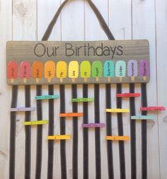 This colorful class birthday chart is the perfect way to display your students birthdays! It can be used year after year! Simply write each students name and the date of their birthday on a clip/clothes pin and clip it in the ribbon hanging under the month of their birth. This wood sign measures 5.5x18 and is completely hand painted and made to order. Hanging ribbons are attached with staples and measure approximately 18 long. Colors can be customized. Matching hand painted clips are ava...