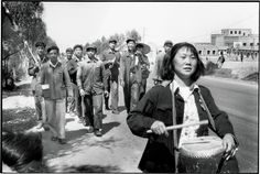 """The image is of a workers' delegation marching in Gansu province, during the Great Leap Forward. This article shares the tale of Mao's """"uneducated infatuation with the signs and symbols of modern progress—gigantic projects and economic statistics"""", that in turn caused a famine that dwarfed even the Incredible Famine of 1876 - 1879."""