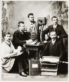 Group of photographers posing in a studio by National Media Museum, via Flickr