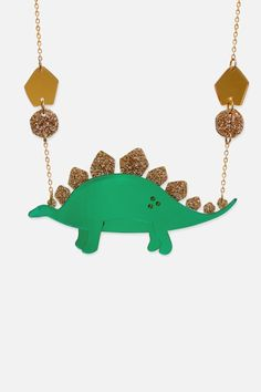"""Awesome stegosaurus necklace handmade from acrylic. Green mirrored acrylic body with gold glittery acrylic spikes and dotty detail. Gold plated chain.    Stegosaurus measures approximately 11cm x 6cm. 16""""   Stegosaurus Dinosaur Necklace by Little Moose. Accessories - Jewelry - Necklaces Edinburgh, Scotland, United Kingdom"""