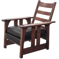 "Description: Early Gustav Stickley Morris chair, #2341, flat-arm form with two vertical slats and corbels at sides, recovered seat and back cushion, replaced sling seat, cleaned original finish, unsigned, 30""w x 34""d x 36.5""h, very good condition  Estimated Value: $3,000 - $4,000(2,9000)"
