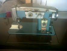 Rheingold sewing machine in cabinet