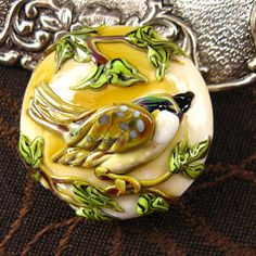 NEW Lampwork Ivory Bird Focal Bead by Kerribeads. $125.00, via Etsy.