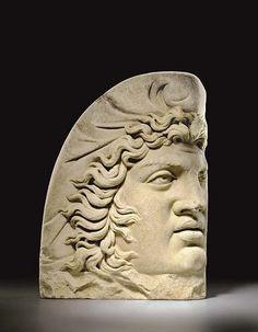 A Roman Marble Acroterion, Perhaps Depicting Attis    A ROMAN MARBLE ACROTERION CIRCA EARLY 3RD CENTURY A.D.