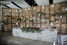 Rustic reclaimed wooden pallet wedding decor | SouthBound Bride www.southboundbride.com/proteas-pallets-rustic-wedding-at-leeuwrivier-by-nikki-meyer-martine-bruno Credit: Nikki Meyer