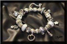 """Pandora and I... Our story began in May, 2011, I met him while I looked for a present for the birthday of my friend, it was the immediate """"love at first sight""""... I celebrated my 40 years some I later in July and guess that it was my request ? A magnificent bracelet Pandora with a charm tortoise, and hedgehog of the animals which I saved. For this day our love was only increasing, I thus present you my bracelet ended this day but our beautiful story always continues..."""