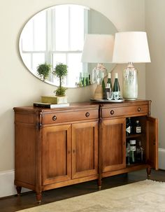 simple mirror with antique buffet