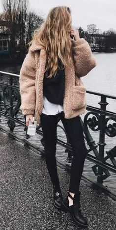 amazing outfit idea : fur jacket + black skinnies + boots + sweater + white top