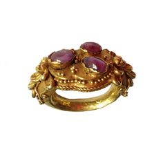 A GOLD AND RUBY RING. Classical Java 9th Century www.ollemans.com SOLD