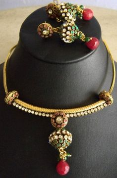 This pretty polki kundan set with a spherical pendant and earrings is simple yet beautiful. It has a copper alloy base with a coating of German silver, and an adjustible fabric cord.  Dangler length: 2 in  - See more at: http://www.giftpiper.com/Polki-Kundan-Spherical-Necklace-Set-id-144179.html#sthash.PvDCXDbh.dpuf