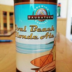 Light blonde with a taste of peaches. - Drinking a Oval Beach Blonde Ale by Saugatuck Brewing Company