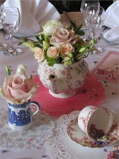 Flowers in tea cups and tea pots!