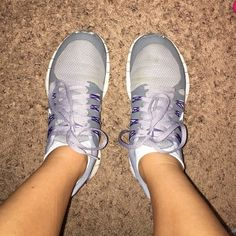 Gray and purple nikes Used and still in very good condition. If you try washing them, the slight discoloring will come out, others than that, they are still in good shape and quality. Open to offers. Nike Shoes Athletic Shoes