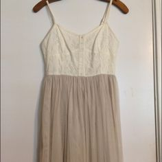 American Eagle Dress Worn once! White/cream top dress with a tan tulle flowy bottom, has loops for a belt on the sides. GREAT Condition! American Eagle Outfitters Dresses