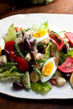 NYT Cooking: The market tomatoes, green beans, peppers, cucumbers and lettuces were irresistible, and we would have been happy to dine on this iconic Provençal salad every day. I'm making the anchovies optional in this recipe, but they are always included in the authentic salade niçoise.