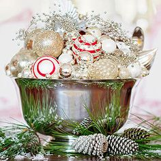 Gather Ornaments in a Bowl- Take a silver bowl: add lovely receptacle for ornaments. A few striped balls add just a pop of color.