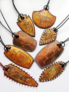 Polymer petroglyph pendants by Shelley Atwood - Polymer clay, wood and more. Inspirational jewelry and objects. Polymer Clay Kunst, Polymer Clay Pendant, Polymer Clay Creations, Polymer Clay Jewelry, Clay Earrings, Polymer Clay Tutorials, Wooden Jewelry, Leather Jewelry, Clay Design