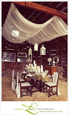 draped fabric in a barn for a wedding reception
