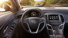 2014 Buick LaCrosse, Adaptive Cruise Control alert displayed in the 8-inch instrument panel.