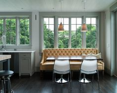 Love this  Kitchen Banquette--Cream Leather Couch and wood table with chairs