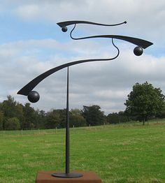 'contemporary mobile sculpture for a garden' I may have to contact the artist about this . . .