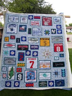 High School Graduation Gift for my friends son, on the quilt frame, ready for basting. He is a golfer and overall sports nut, so an atheltic theme was appropriate for this one.