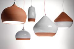 Terracotta pendant lights.   A modern take on taverna lighting, the terracotta pendant is having a renaissance. http://www.remodelista.com/posts/this-weeks-table-of-contents-greek-isles-may-2014