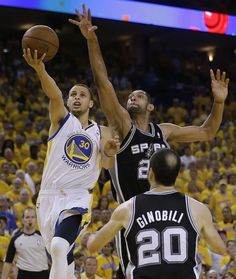 Golden State Warriors' Steph Curry scores in overtime over San Antonio Spurs' Tim Duncan in a 2nd round playoff victory