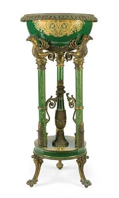 Rare French Napoleon III Gilt-Bronze Mounted Porcelain and Enamel Jardinière, by Sèvres, the circular basin with cast foliate rim and decorated with cornucopia within foliate scroll ornament, supported on turned columns headed by mythical birds united by a center standard, on circular plinth and outswept feet ending in talons. Circa: 1870.