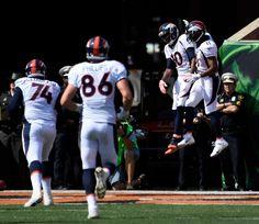 Denver Broncos wide receiver Emmanuel Sanders (10) celebrates with Denver Broncos wide receiver Jordan Norwood (11) after his touchdown catch on Cincinnati Bengals cornerback Adam Jones (24) and Cincinnati Bengals free safety George Iloka (43) during the first quarter September 25, 2016 at Paul Brown Stadium. John Leyba, The Denver Post