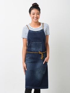 Our Workers Collection is all about delivering authentic design-led styles that are fit for work. The roots of the collection stem from uniforms worn by yesteryear's working heroes, a time when sturdy work wear got the job done. The Workers Bib Apron in Indigo Denim is detailed with sturdy statement pockets and genuine rope apron straps ensuring a durable and practical finish. Also available in a waist apron. Features: 100% cotton denim cross back with new rope straps front chest pocket…