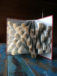 Squares - Uhuru: A Novel of Africa Today - Folded Book Art - Recycled, Repurposed, Reclaimed Old Book Crafts, Book Page Crafts, Folded Book Art, Paper Book, Recycled Art, Repurposed, Altered Book Art, Origami Paper Art, Magazine Crafts