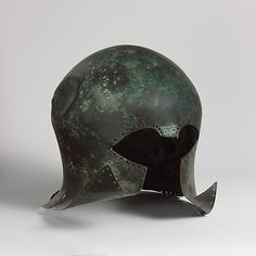 Bronze helmet of Corinthian type Date: ca. 650-600 B.C. The historian Herodotos mentions the Corinthian helmet as part of the equipment of the Greek hoplite (foot soldier). As a result, the predominant type of helmet, with a rounded calotte, small openings for the eyes, and a distinct nose-piece has been identified as such. Thanks to the large number of examples excavated at Olympia, the typological variety and development are well understood. This example, said to be from Olympia...