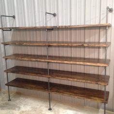 This custom retail shelving will really make products stand out with dark walnut stain and oil rubbed bronze supports. This is great for featured items in a store or for extra deep home shelving.