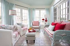 Stylish sunroom with modern beach style in white, blue and red [Design: Lindsey Hene Interiors]