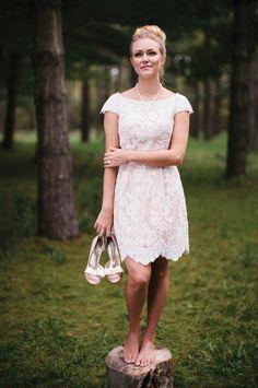 Cap-sleeved, short wedding dress: Sherri Hill pale pink reception dress, $650 at Normans Bridal in Springfield. Jonathan Kayne bow tie peep-toe shoes, $82 at Gracie's Bridal.