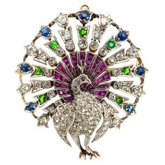Peacock Brooch unknown 1900 Body of rose cut diamonds, tail feathers are all sapphires, rubies and demantoid garnet, in addition to old european cut diamonds.