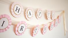 Graduation Banner on accordian folded paper circles and ribbon//boxwood clippings_diy birthday banner