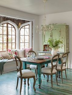 Interesting floor & gorgeous windows .I would pull the dining table up to the window seat to make a different look.