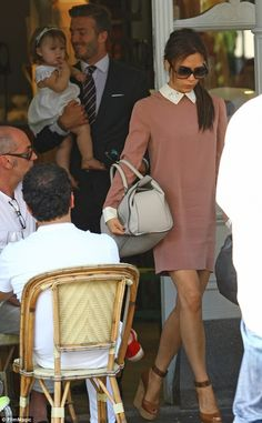 Victoria Beckham wearing Lanvin Puzzle Wedge Pump, Victoria by Victoria Beckham Satin Back Crepe Swan Collar Dress and Victoria Beckham the Soft Victoria Leather and Watersnake Tote.
