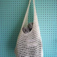 This bag is a simple project, great for novices to crochet.  The white sample was made with a 5mm crochet hook, grey was made with a 3.75mm hook.  Materials 3.75mm Crochet Hook 420m DK weight cotton yarn (2 skeins Cascade Ultra Pima ) 1 split ring stitch marker  See projects on Ravelry.