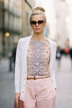 Interesting juxtaposition of glitzy beaded work with very casual wear.