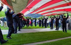 The National 9/11 Flag is unfolded at the memorial's opening   http://usat.ly/RVjUw7 (AP photo)