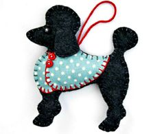 Handmade Poodle ornament for Christmas or any occasion. Lulu is made from felt, with a jolly buttoned jacket in printed cotton, and a cotton loop