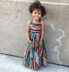 Little girls maxi dress in gorgeous Ankara fabric! This style has an elasticized back waist band, and halter style straps. Great piece to transition into fall by layering underneath or throwing on a jacket over as the weather gets colder! #littlegirloutfits