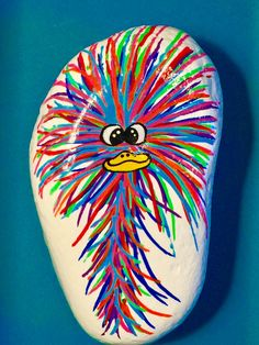 Funny, crazy haired bird. Painted rock.